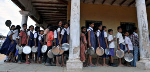 Indian schoolchildren wait in line for their mid-day meal at a government primary school in the outskirts of Hyderabad on June 13, 2011, on the opening day of the new academic year. The government of India's Andhra Pradesh state has introduced English as a second language from Class 1 onwards for the 2011-2012 academic year. India's National Knowledge Commission has admitted that no more than one percent of country's population uses English as a second language. AFP PHOTO/Noah SEELAM (Photo credit should read NOAH SEELAM/AFP/Getty Images)