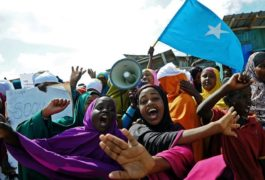 Demonstrators hold placards during a protest against Al shabab insurgents outside Lido beach in the Somali capital Mogadishu, on January 28, 2016. Al Shebab killed at least 19 people when five gunmen detonated a bomb before storming a restaurant in the at Lido beach on January 22, 2016.  / AFP / MOHAMED ABDIWAHAB        (Photo credit should read MOHAMED ABDIWAHAB/AFP/Getty Images)