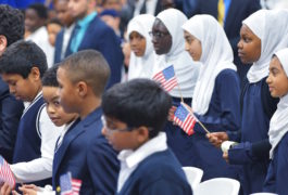 """Children hold US flags as US President Barack Obama speaks in an overflow room during a visit to the Islamic Society of Baltimore, in Windsor Mill, Maryland on February 3, 2016. Obama offered an impassioned rebuttal of """"inexcusable"""" Republican election rhetoric against Muslims Wednesday, on his first trip to an American mosque since becoming president seven years ago. / AFP / MANDEL NGAN        (Photo credit should read MANDEL NGAN/AFP/Getty Images)"""